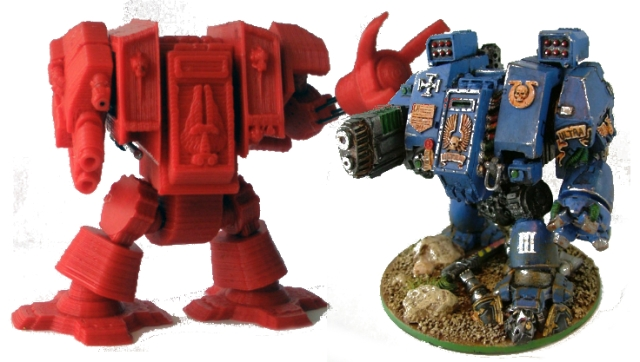 A 3d printed, Warhammer 40k inspired dreadnought on the left, and an official Warhammer 40k dreadnought miniature on the right